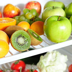 Fresh fruit on a shelf of a fridge